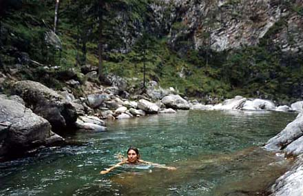 Celine is swimming in a river at Arshan, photo by WayToRussia.Net