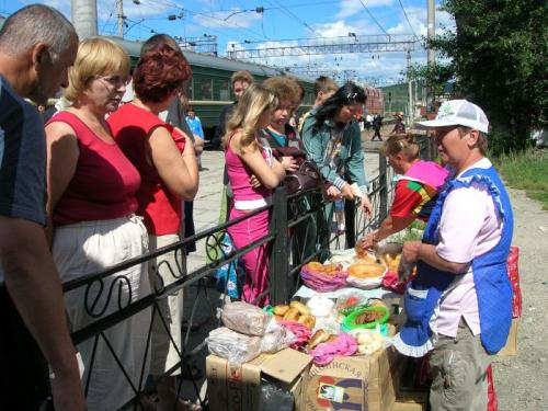 People buying food at a Trans-Siberian stop